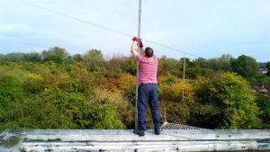 G4NAQ fixing the HF Dipoles on the SARC Club Roof